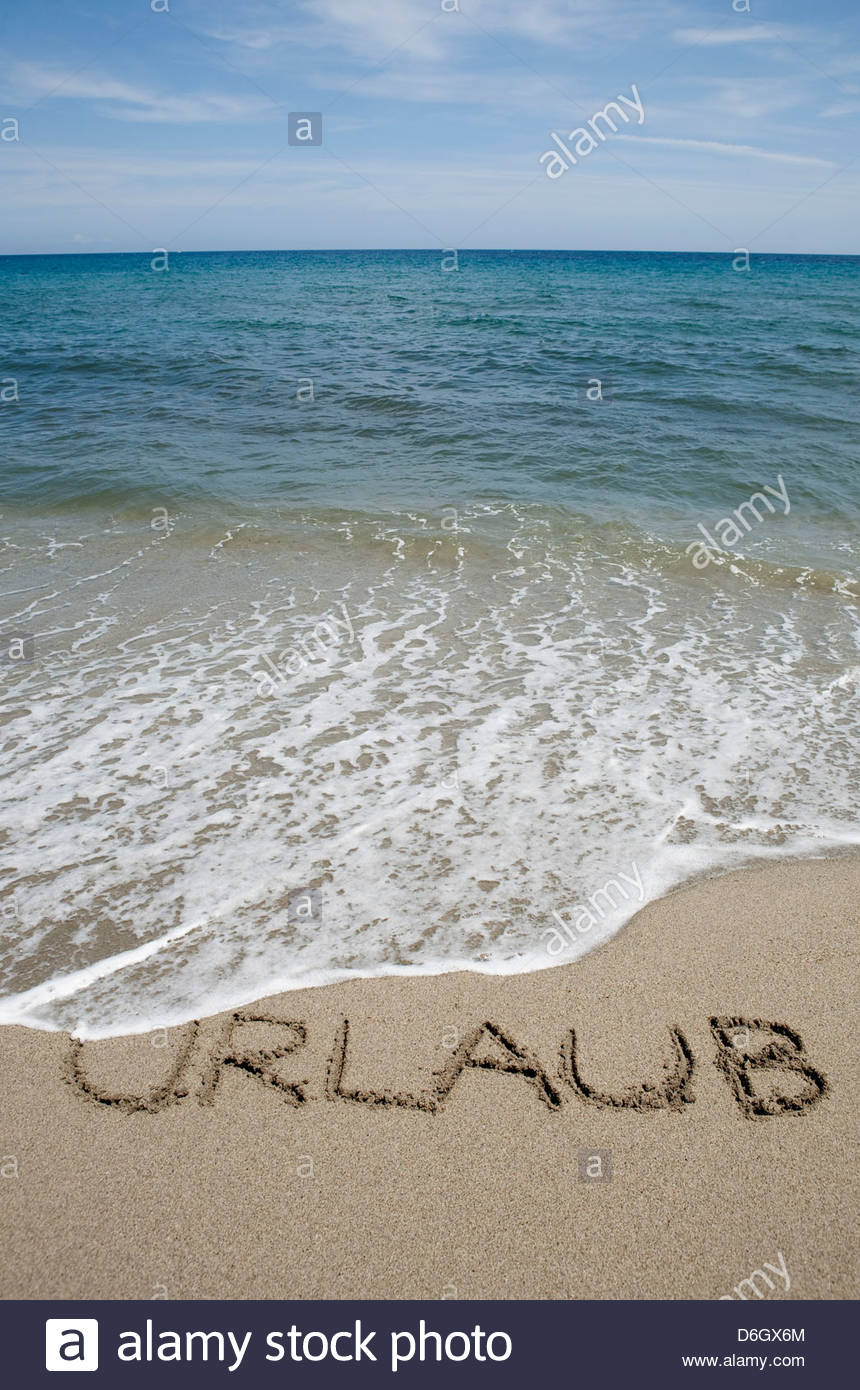 German word for holiday written in sand Prunete Corsica - Stock Image