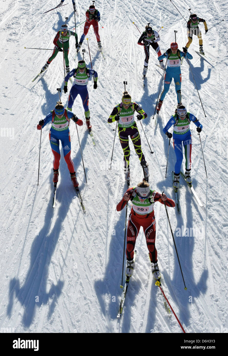 The female biathletes start in the mixed relay event of the Biathlon world championship 2012 at the Chiemgau Arena - Stock Image