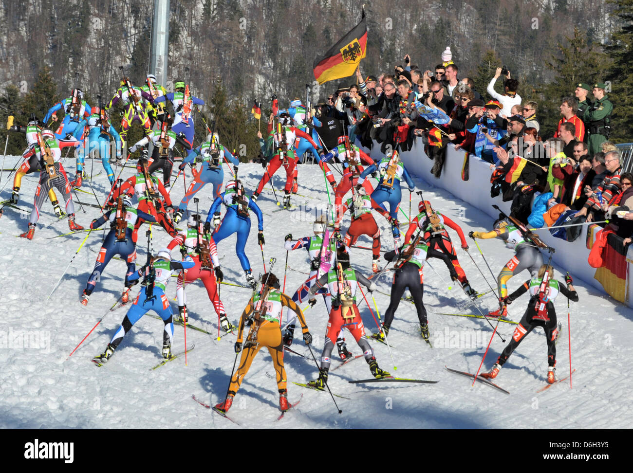 The female biathletes start in the mixed relay event of the Biathlon world championships 2012 at the Chiemgau Arena - Stock Image