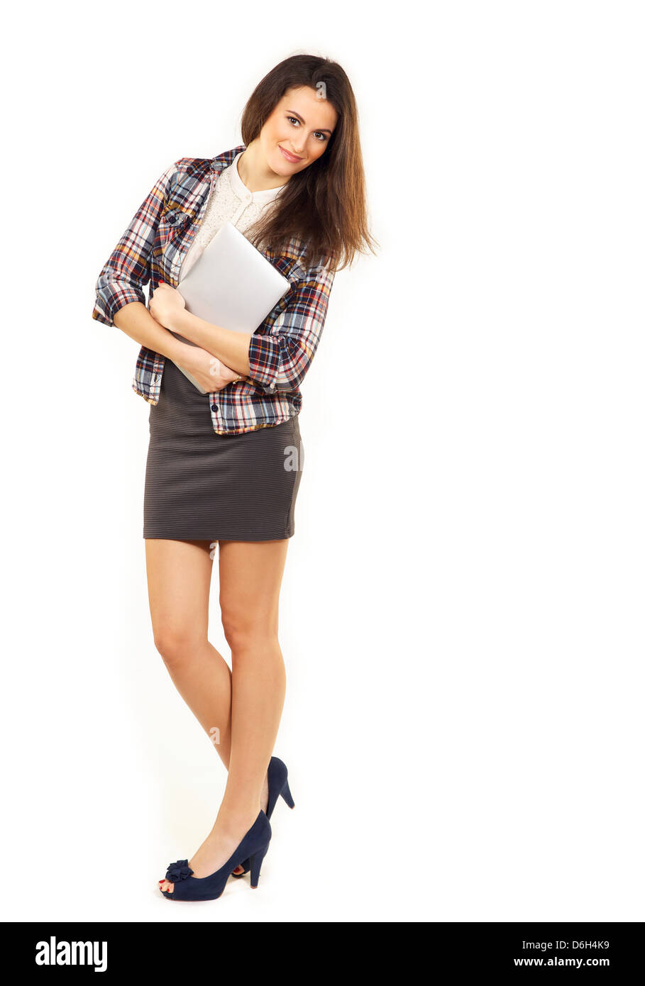 Stylish and confident student holding her laptop isolated against white background Stock Photo