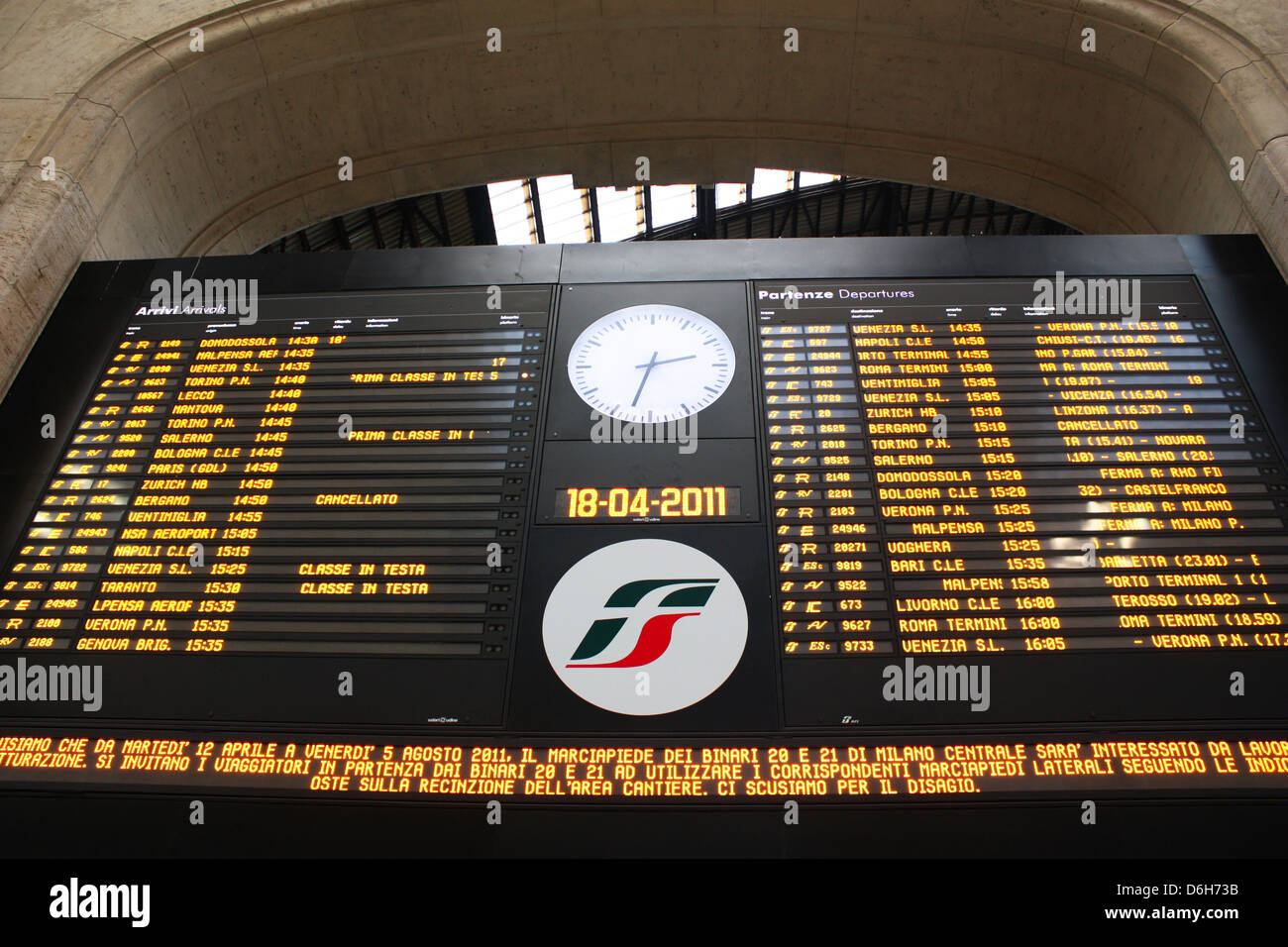 Train timings display board in Milan, Italy railway station Stock Photo