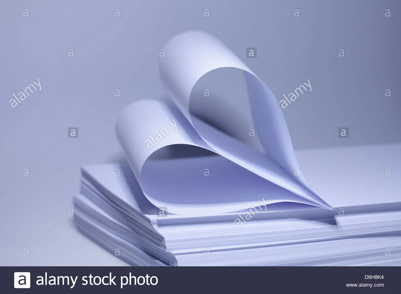 Sheets Paper folded in heart shape Stock Photo