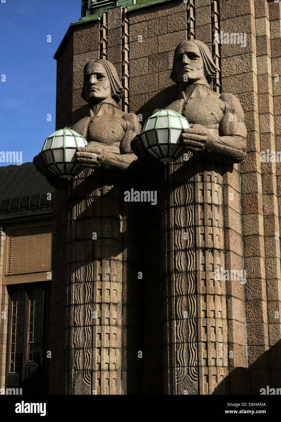 Finland. Helsinki. The torchbearer lamps. Granite sculptures by sculptor Emil Wikstrom (1864-1942). Central Railway - Stock Image