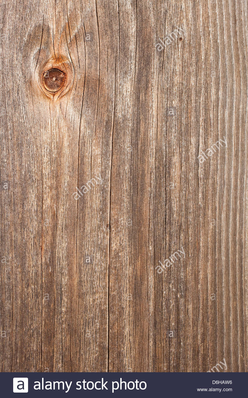 Wood grain old knot door weathered detail close up - Stock Image