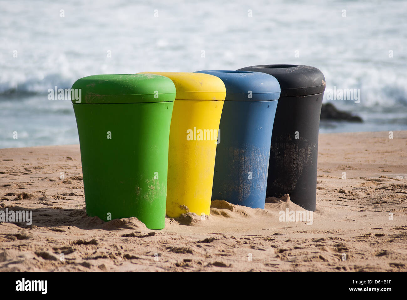 Rubbish bins on Cascais beach Portugal - Stock Image
