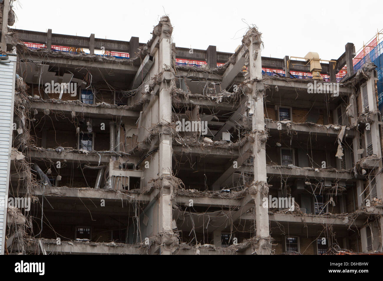 A building is half way thru demolition leaving exposed internals - Stock Image