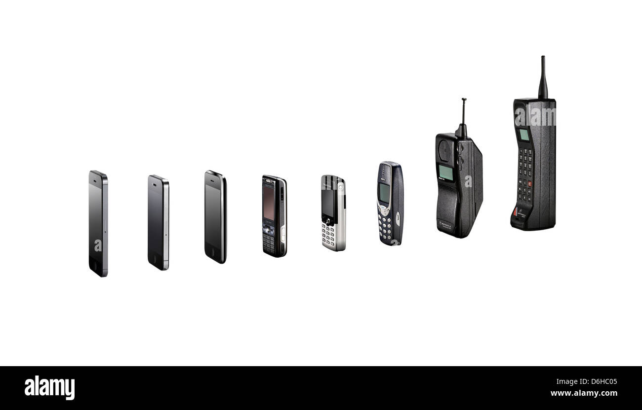 A range of mobile phones showing their evolution without shadows, shot as cutouts. - Stock Image