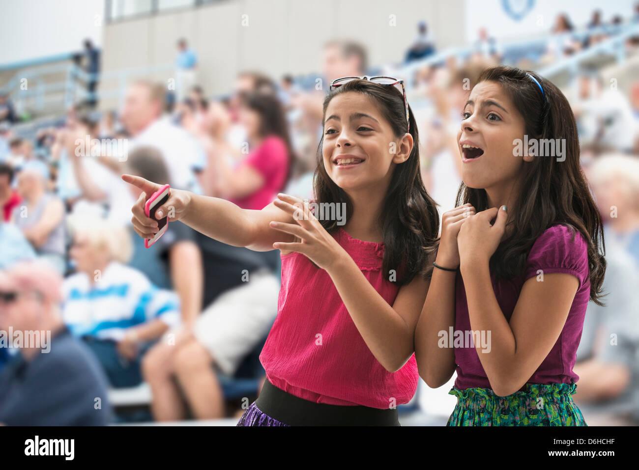 Adoring girls at pop concert - Stock Image