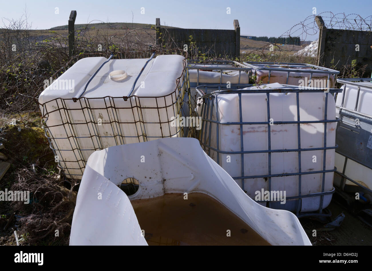 Abandoned chemical containers - Stock Image