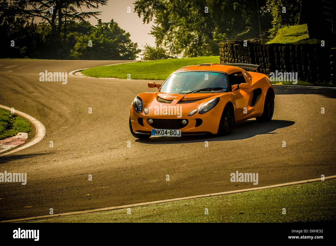 Orange Lotus Exige Car At Cadwell Park Racetrack   Stock Image