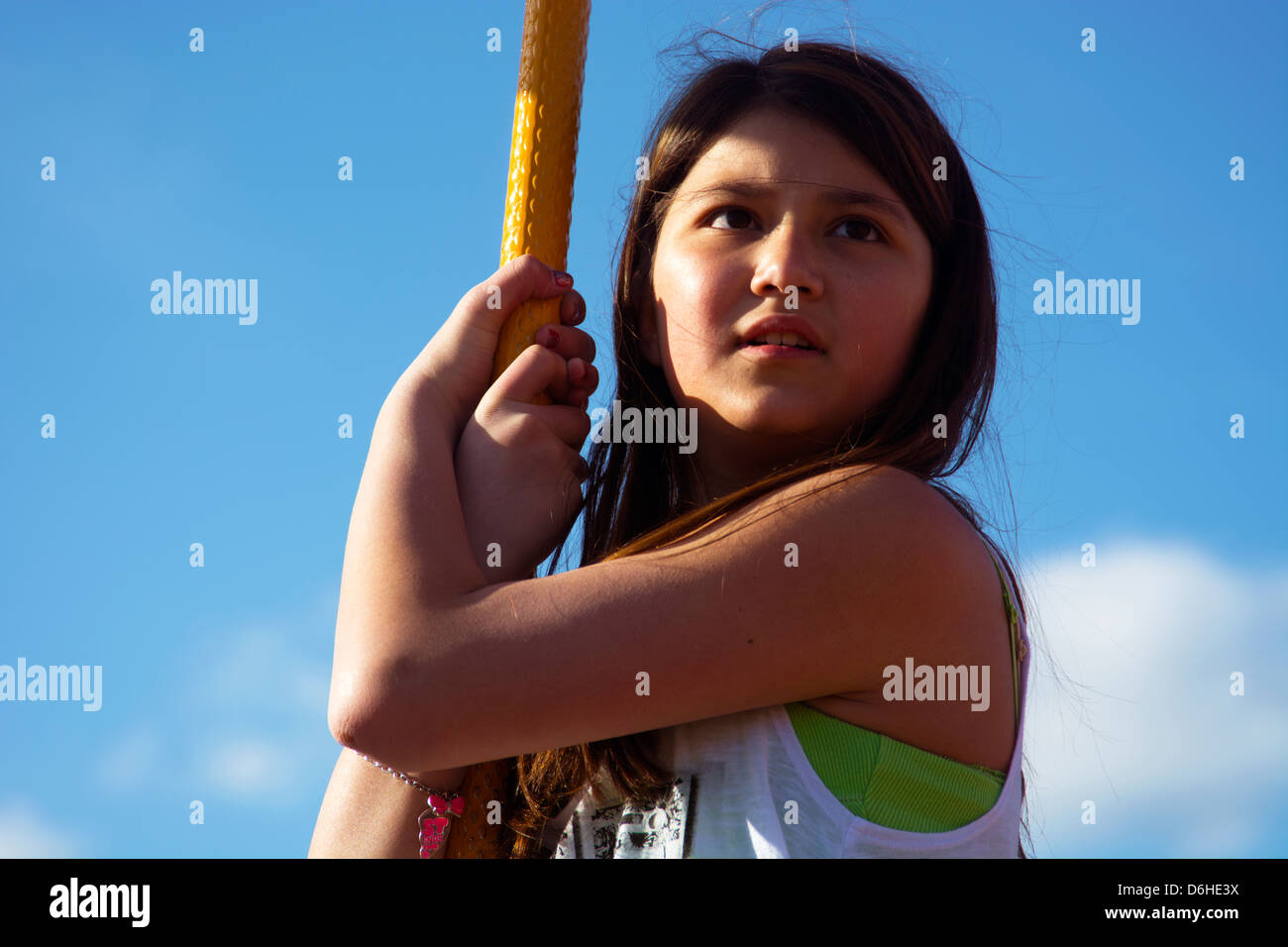 Serious Young Girl On Playground - Stock Image