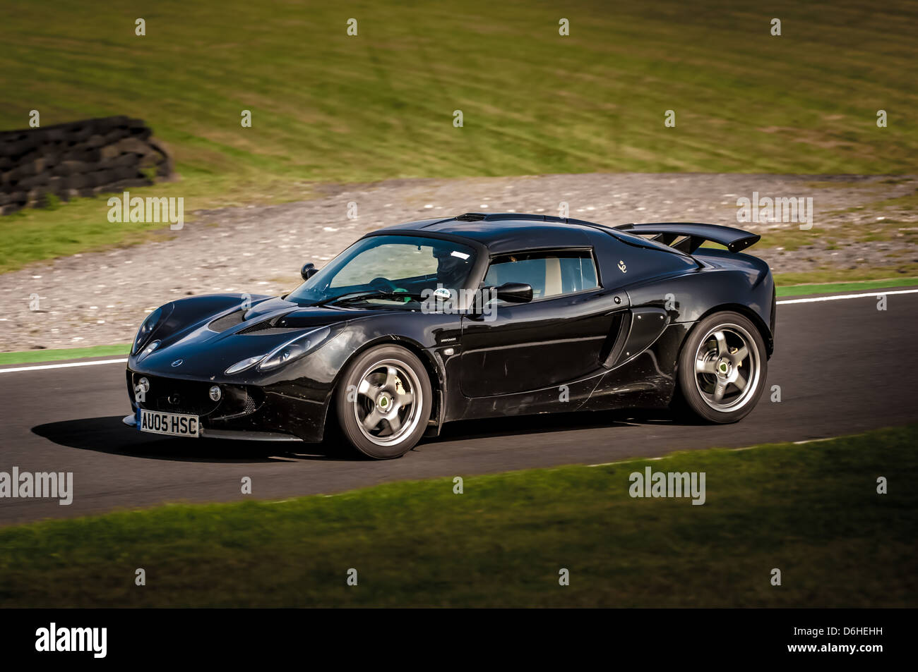 Front And Side View Black Lotus Exige Car At Cadwell Park Racetrack