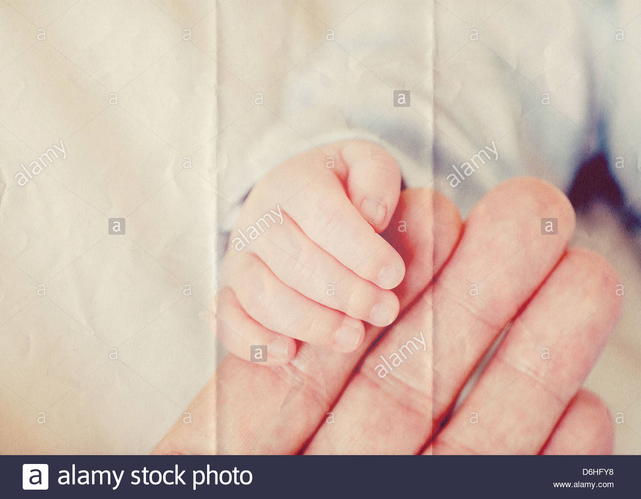 baby hand paper texture - Stock Image