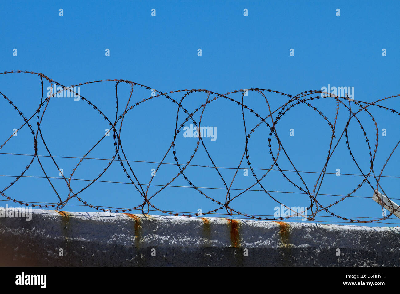 Barbed wire fence, Robben Island, Table Bay, Cape Town, South Africa Stock Photo