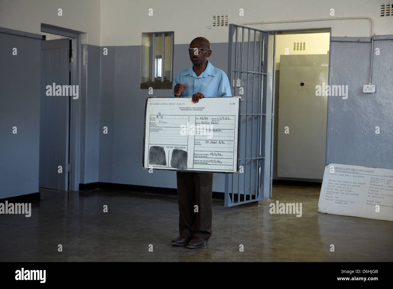 Tour guide and ex-political prisoner inmate, Robben Island Prison, Table Bay, Cape Town, South Africa - Stock Image