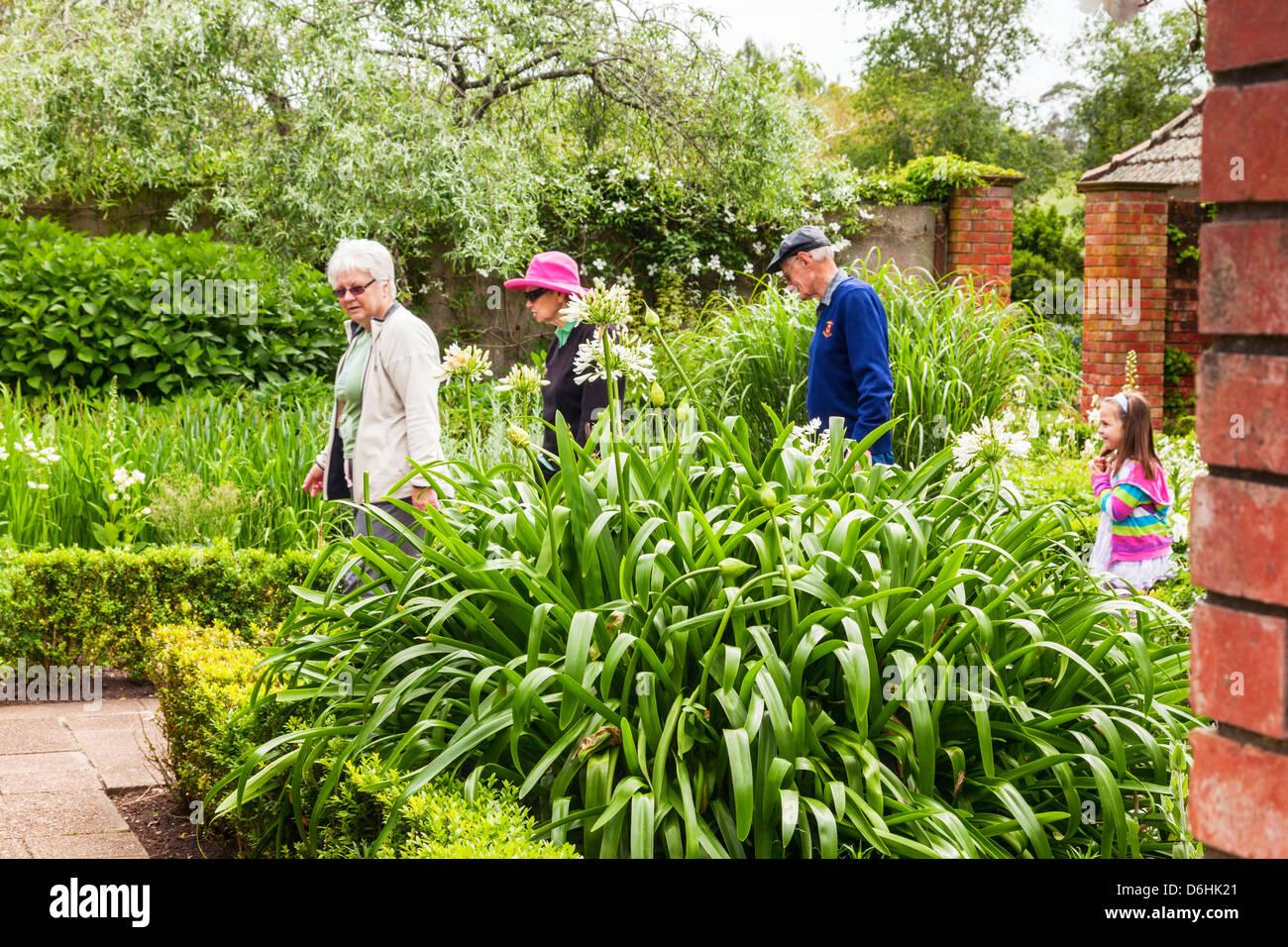 Visitors looking around the English Flower Garden, Hamilton Gardens, Hamilton, Waikato, New Zealand. Focus on foreground. - Stock Image