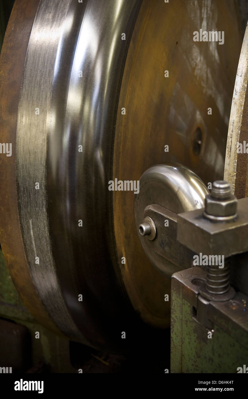 Industrial lathe and former used for metal spinning process - Stock Image