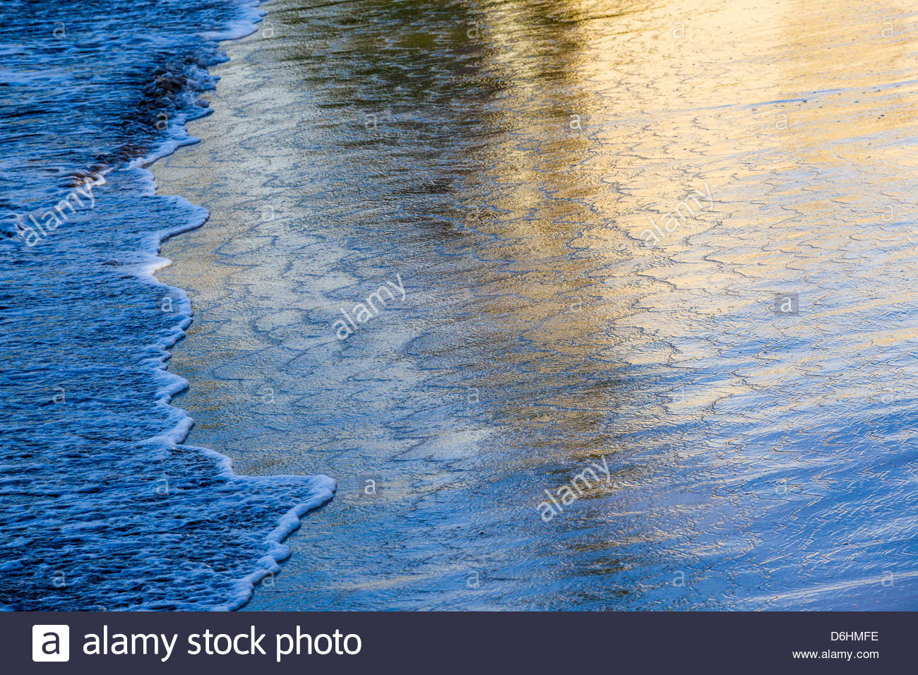 Morning reflections on ocean surface at Sugar Beach in Kihei on the island of Maui in the State of Hawaii USA - Stock Image