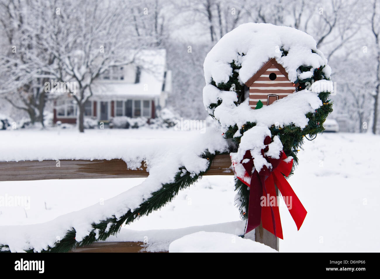 Bird House on Fence Post in the Snow Decorated for Christmas near ...