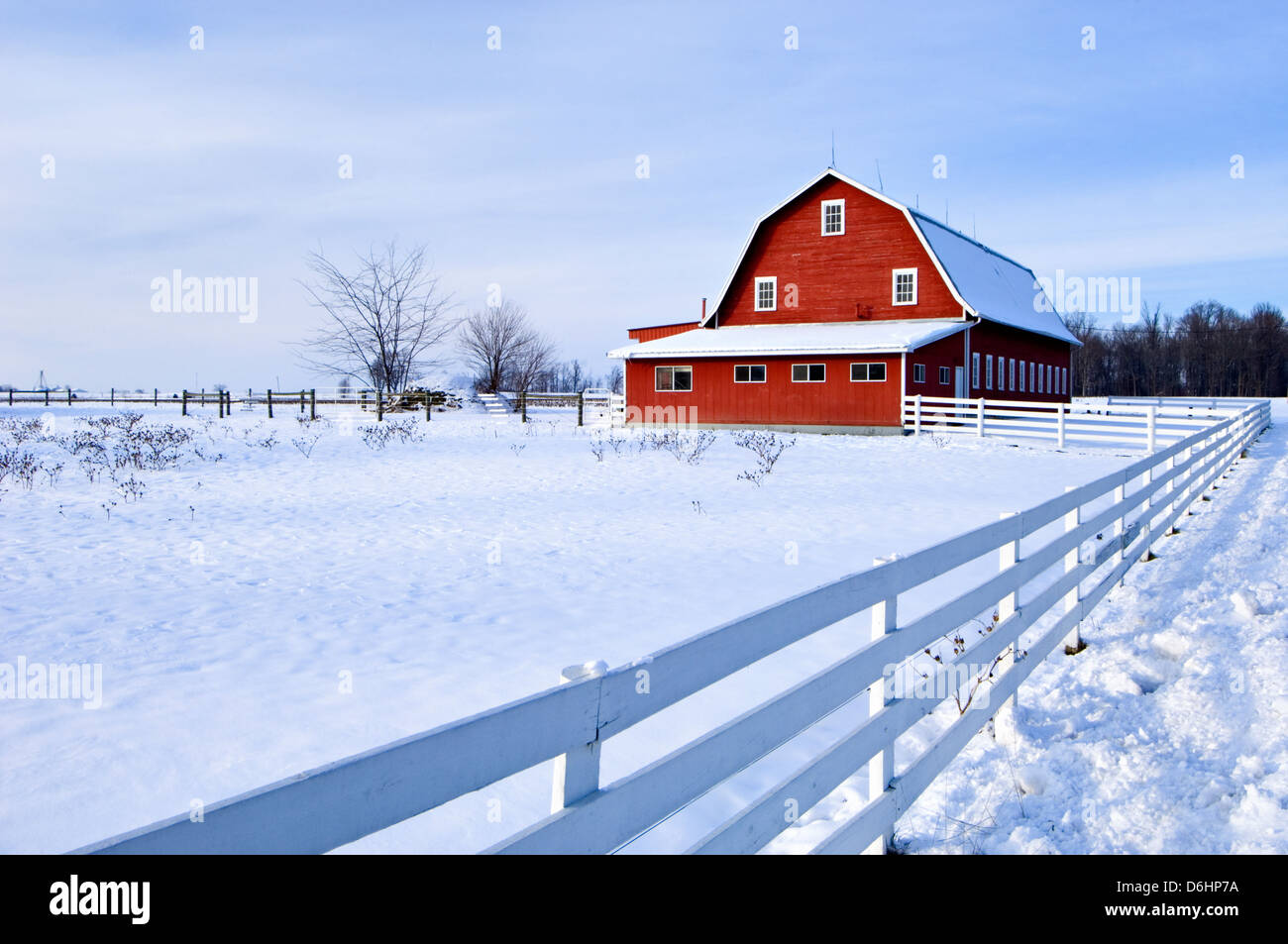 Red Barn and Snow in Jackson County, Indiana - Stock Image