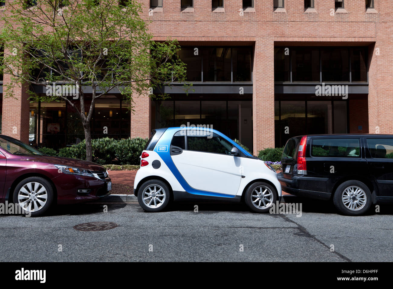 SmartCar parked in between two cars - Stock Image