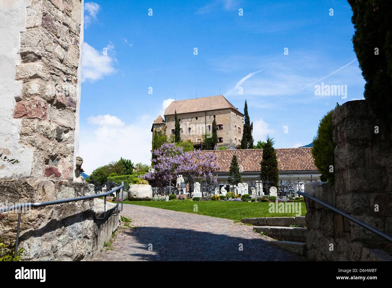 Eastern Alps, South Tyrol, Italy. Schenna (Scena) near Meran (Merano) with church Maria Aufnahme, and castle. Stock Photo