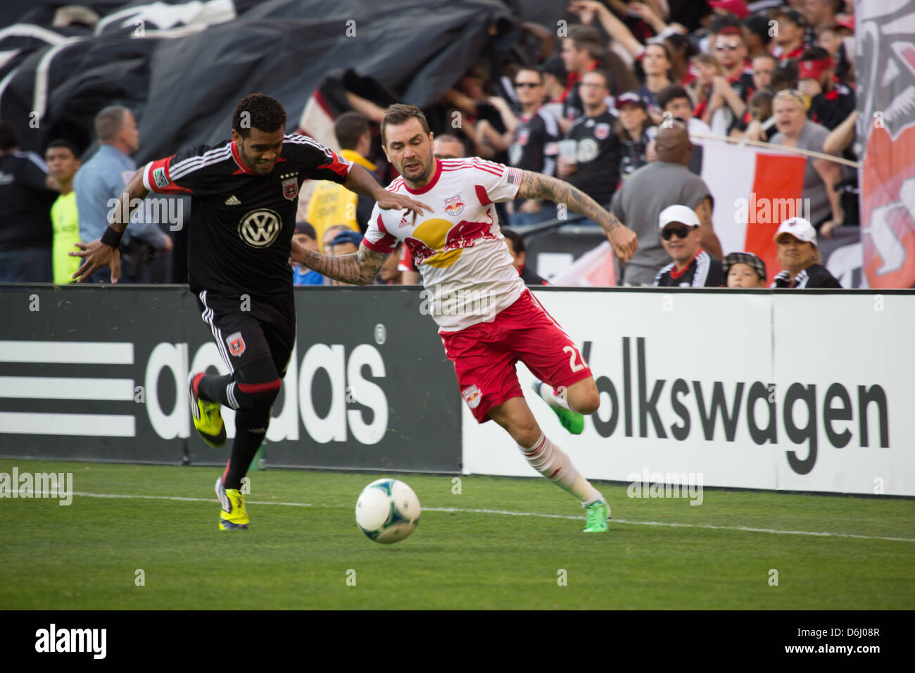 April 13th 2013 D.C. United midfielder Raphael Augusto (12) fights for the ball with NY RedBulls (27) Kosuke Kimura. - Stock Image