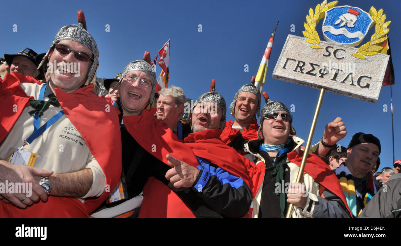 Fans costumed as Romans cheer at the stands during the mixed relay team competition of the Biathlon World Championships - Stock Image