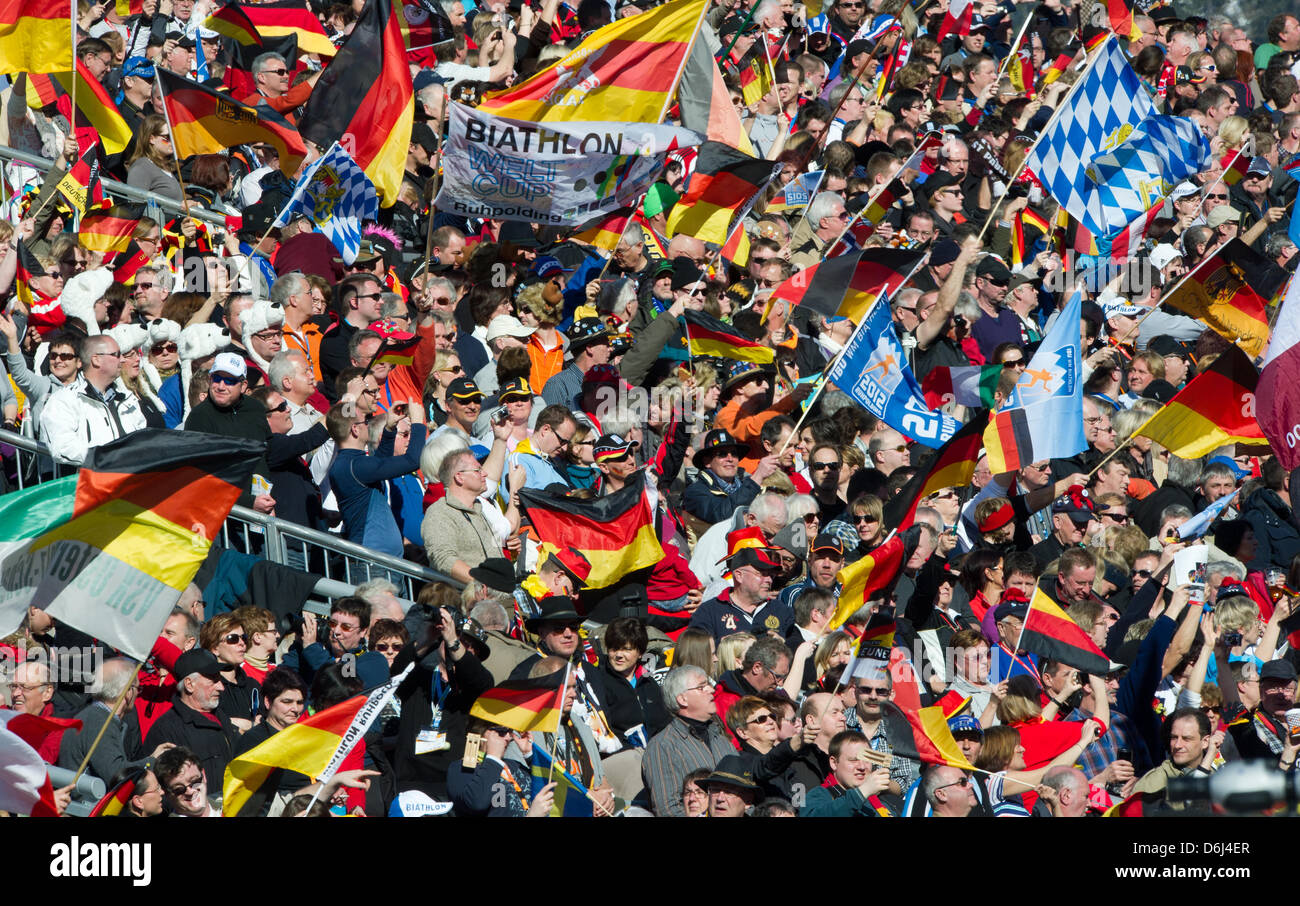 Fans wave with flags on the stands during the mixed relay team competition of the Biathlon World Championships at - Stock Image