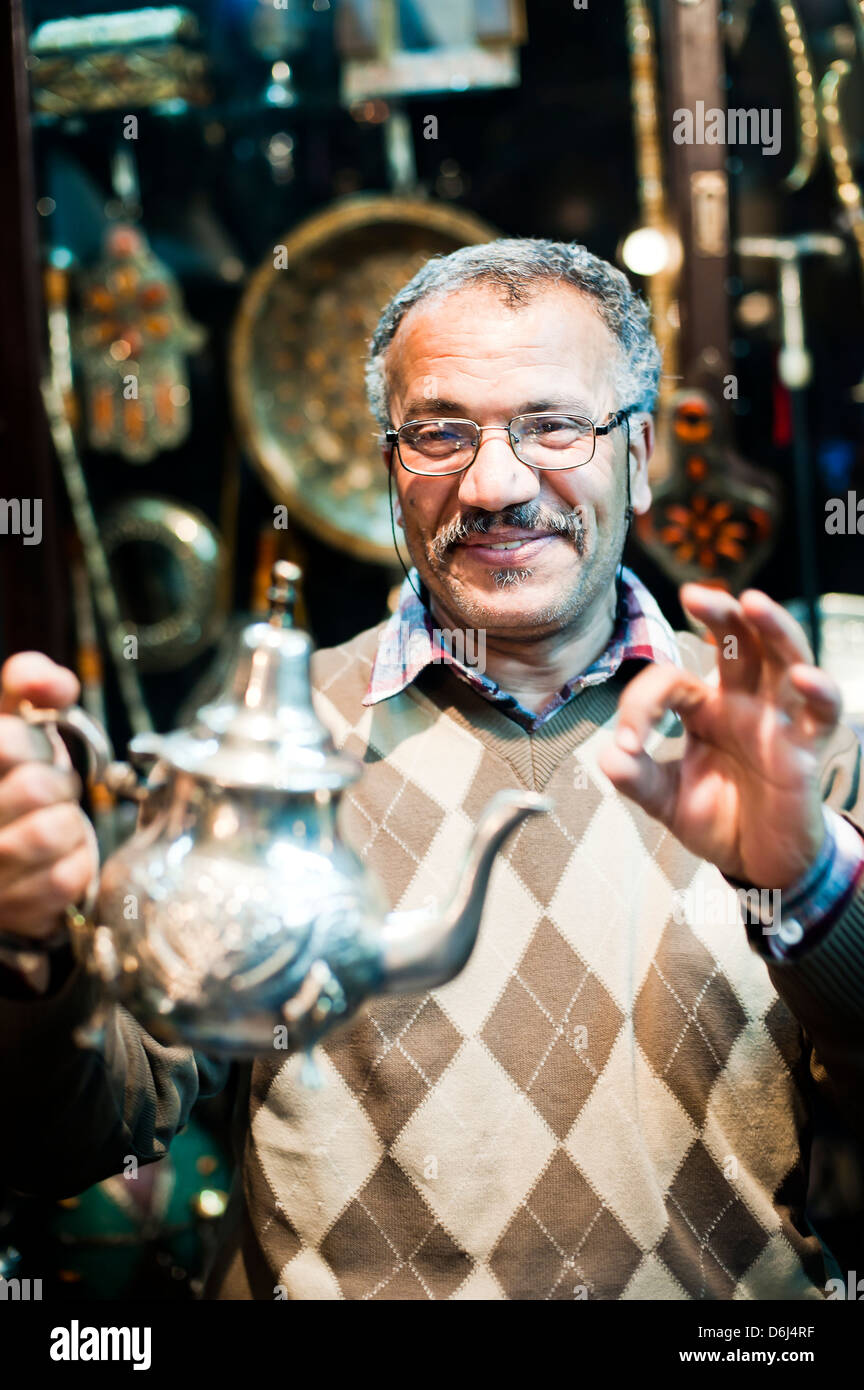 Moroccan teapot vendor in Marrakech souk and market, Morocco, North Africa, Africa - Stock Image