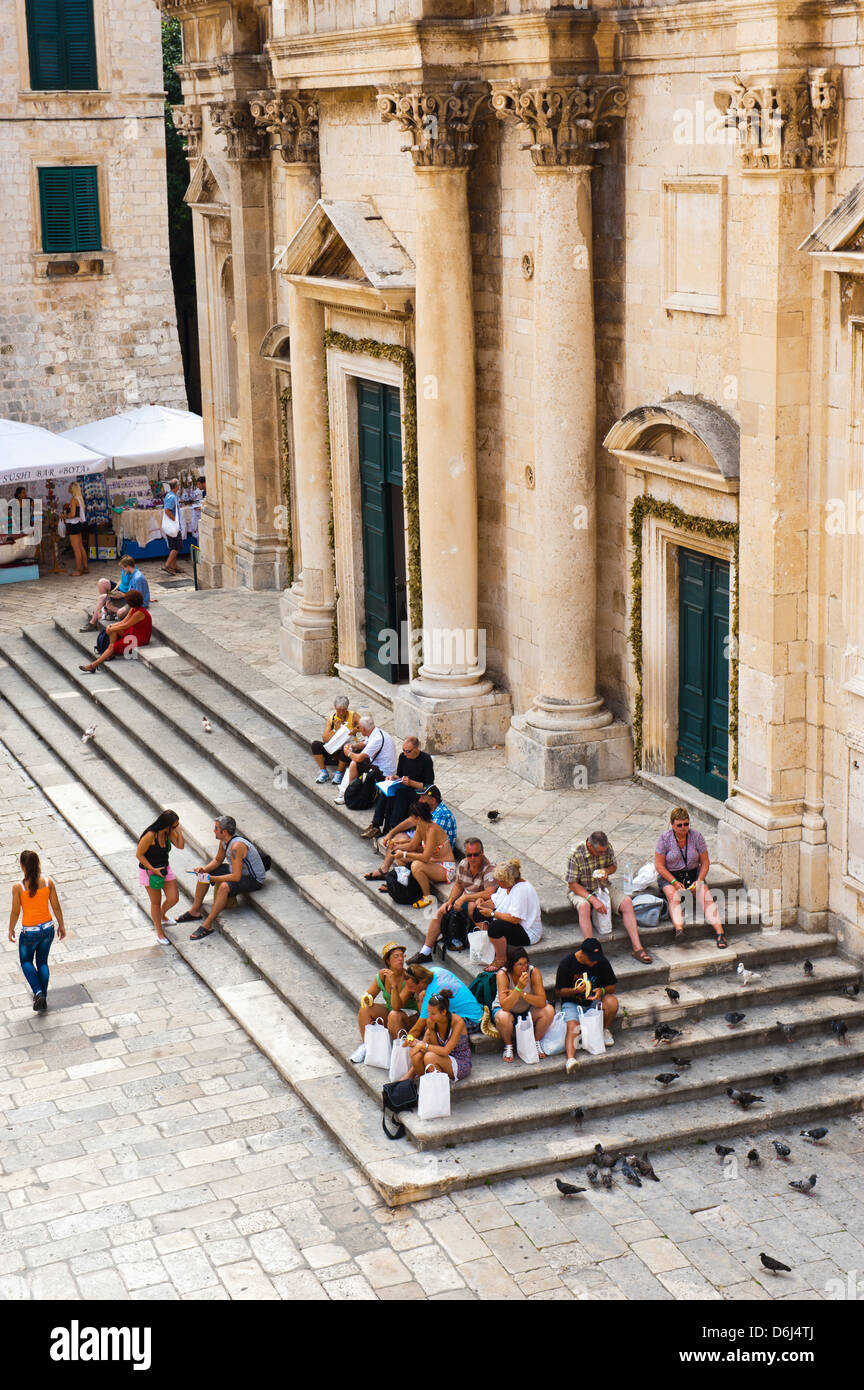 Tourists on the steps of Dubrovnik Cathedral (Cathedral of the Assumption of the Virgin Mary), Dubrovnik, Croatia, - Stock Image