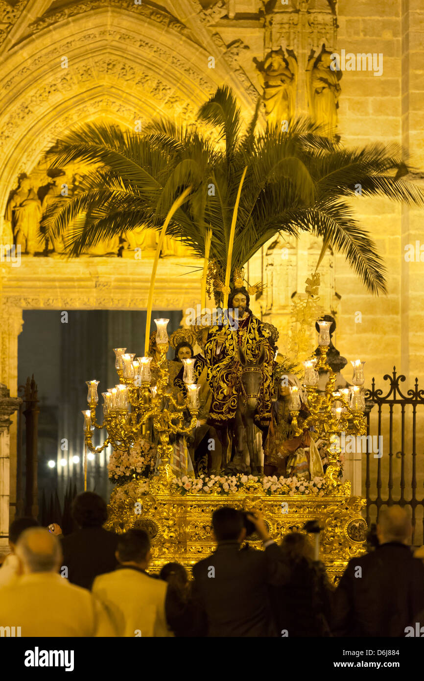 Semana Santa (Holy Week) float with image of Christ outside Seville cathedral, Seville, Andalucia, Spain, Europe - Stock Image