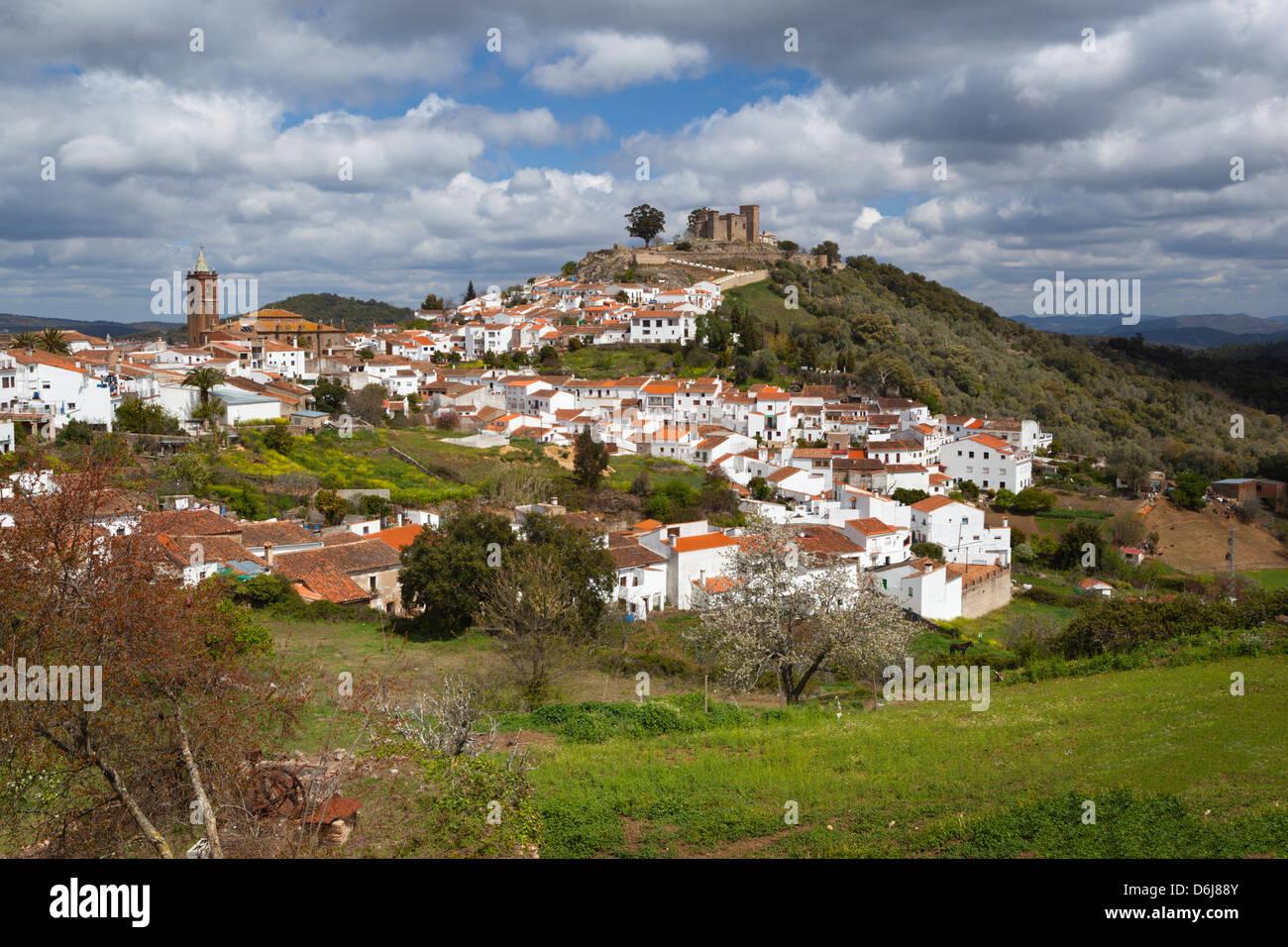 White pueblo and 13th century castillo, Cortegana, Parque Natural Sierra de Aracena y picos de Aroche, Huelva, Andalucia, - Stock Image