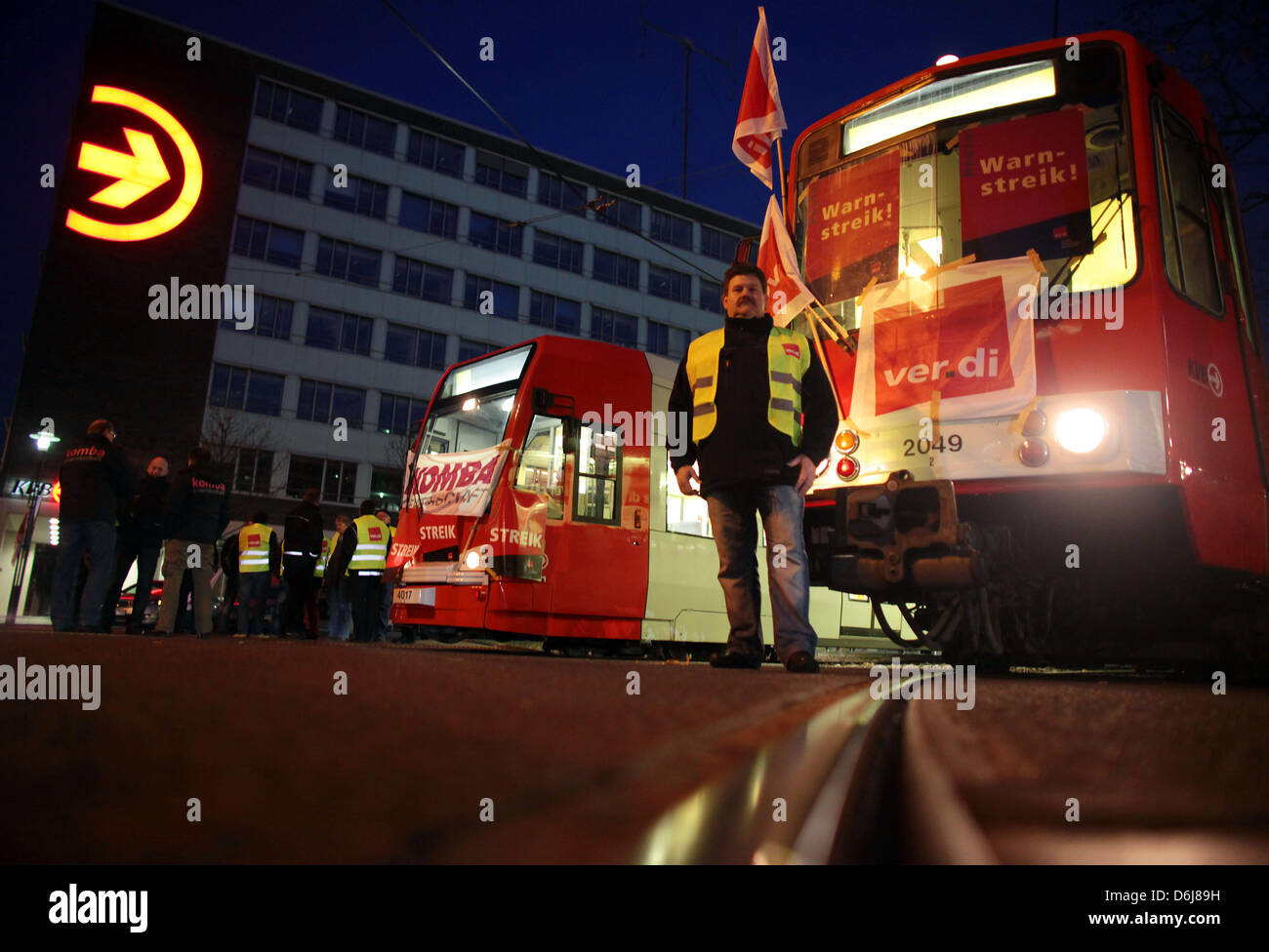 Trade unionists of Verdi stand in front of street cars in Cologne, Germany, 07 March 2012. Due to tarif conflicts - Stock Image