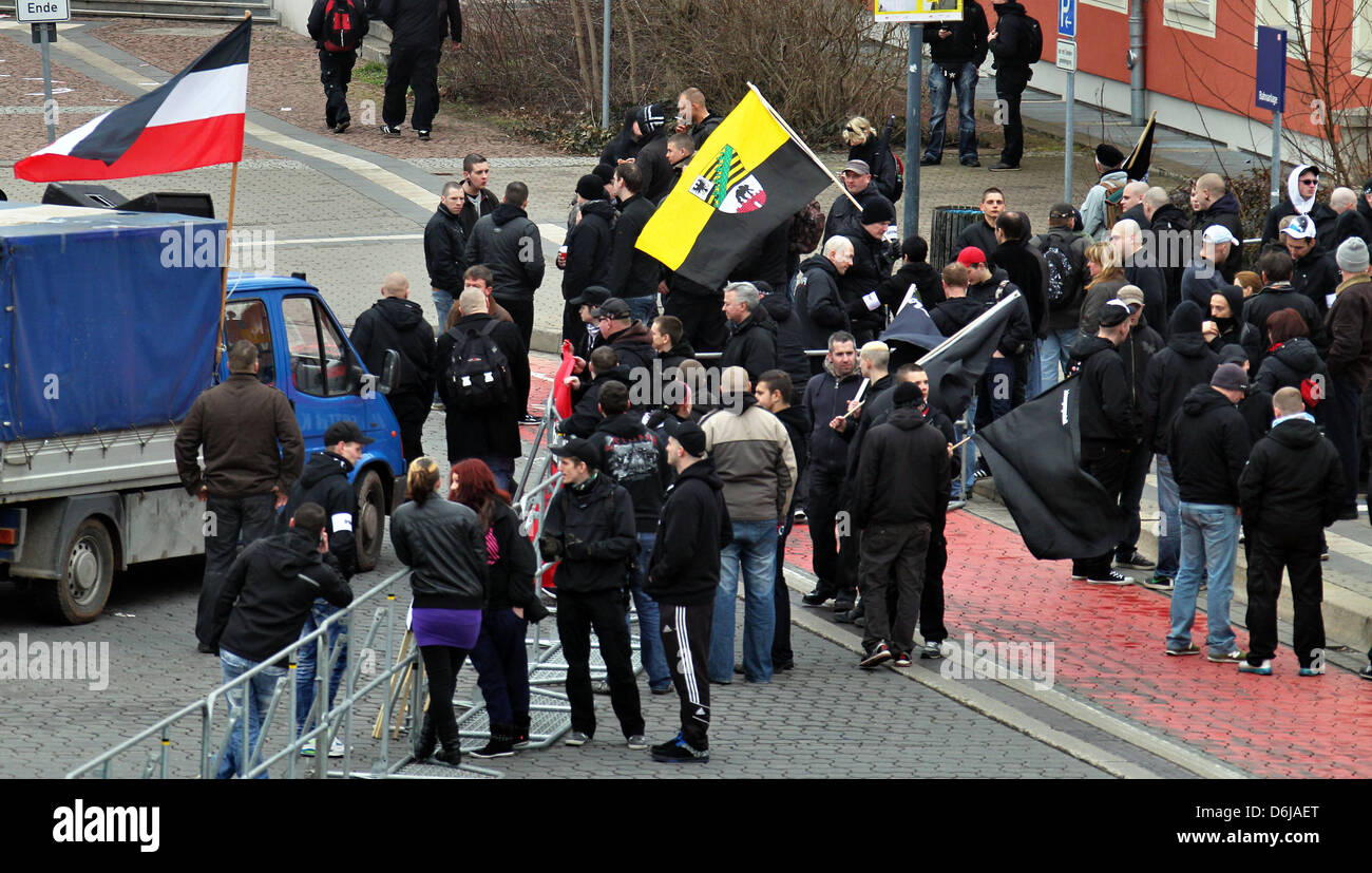 Participants of a far-right extremist rally stand behind barricades in Dessau-Rosslau, Germany, 10 March 2012. People - Stock Image