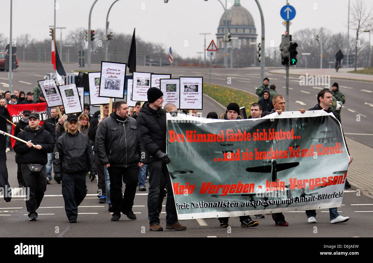 Participants of a far-right extremist rally march through Dessau-Rosslau, Germany, 10 March 2012. People are protesting - Stock Image