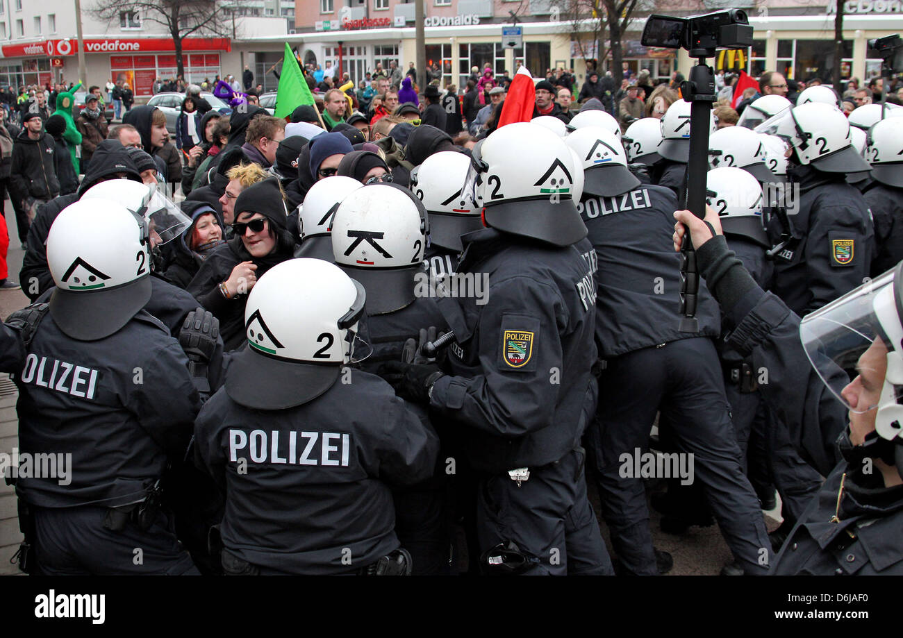 Counter-demonstrators push towards a far-right extremist rally in Dessau-Rosslau, Germany, 10 March 2012. People - Stock Image
