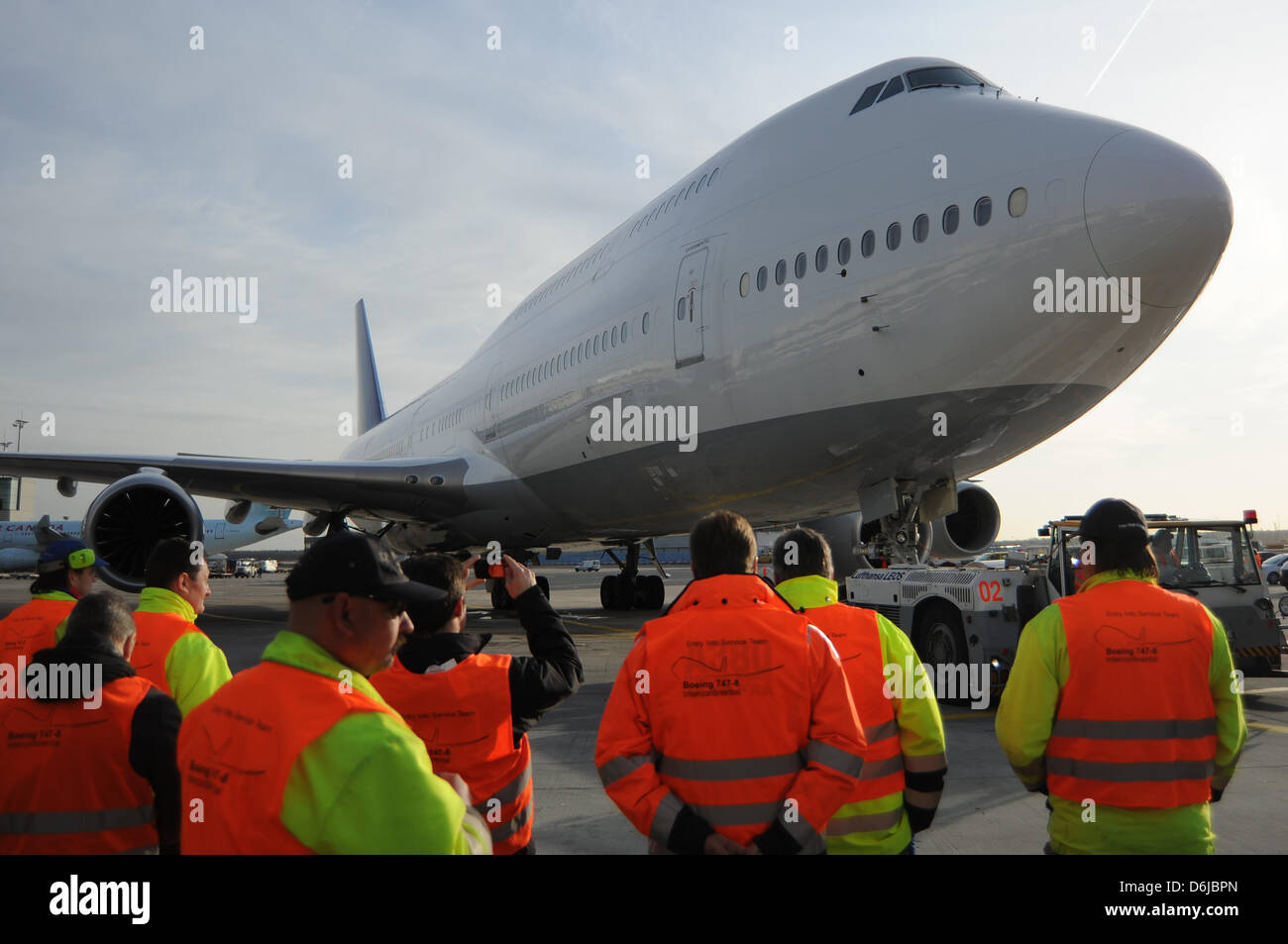 A Boeing 747-8 Intercontinental aircraft rolls to a gate at the airport in Frankfurt am Main, Germany, 08 December - Stock Image
