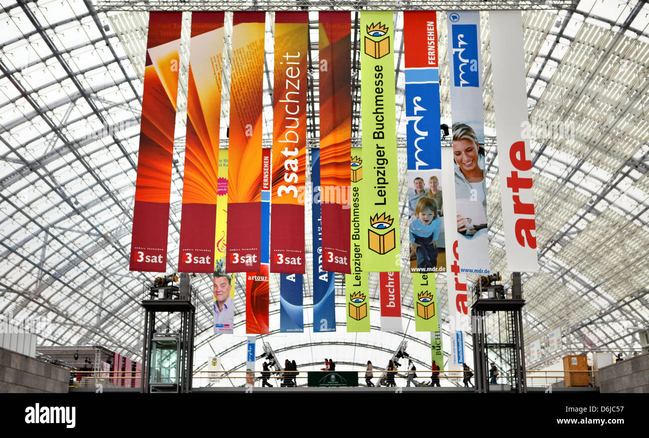 People walk through the glass hall at the Leipzig Messe in Leipzig, Germany, 13 March 2012. 160,000 visitors are - Stock Image