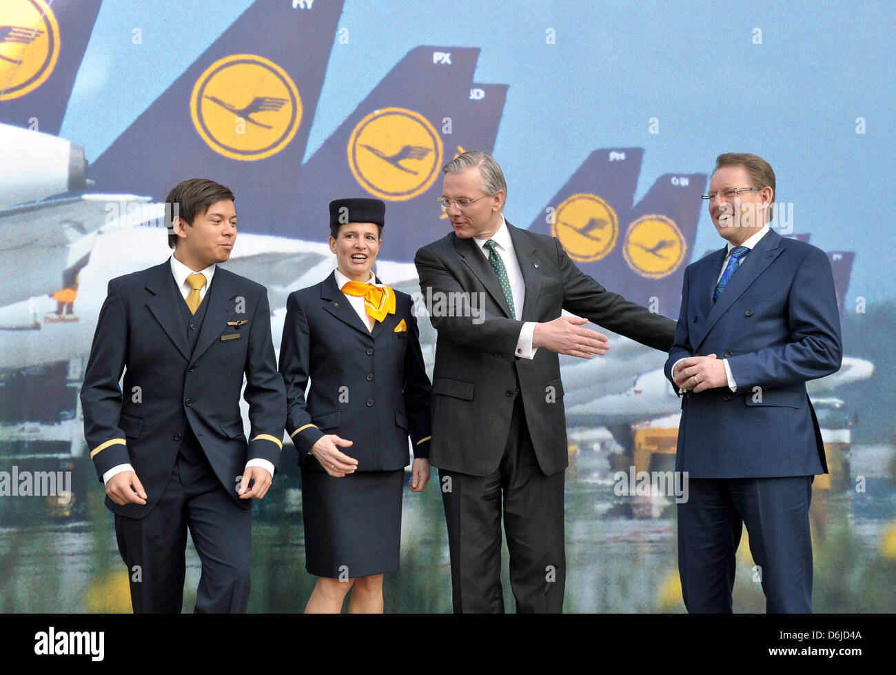 Lufthansa AG CEO, Christoph Franz (2-R), and managing board member Stephan Gemkow (R) stand in front of a photo - Stock Image