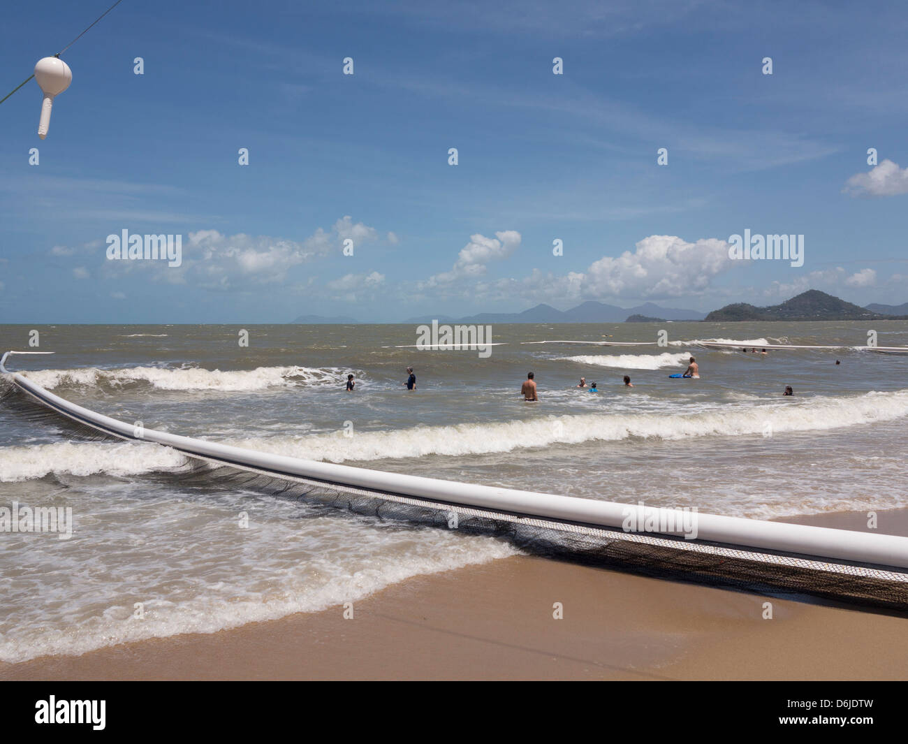 People swimming within stinger protection net at Palm Cove, Cairns, North Queensland, Australia, Pacific - Stock Image