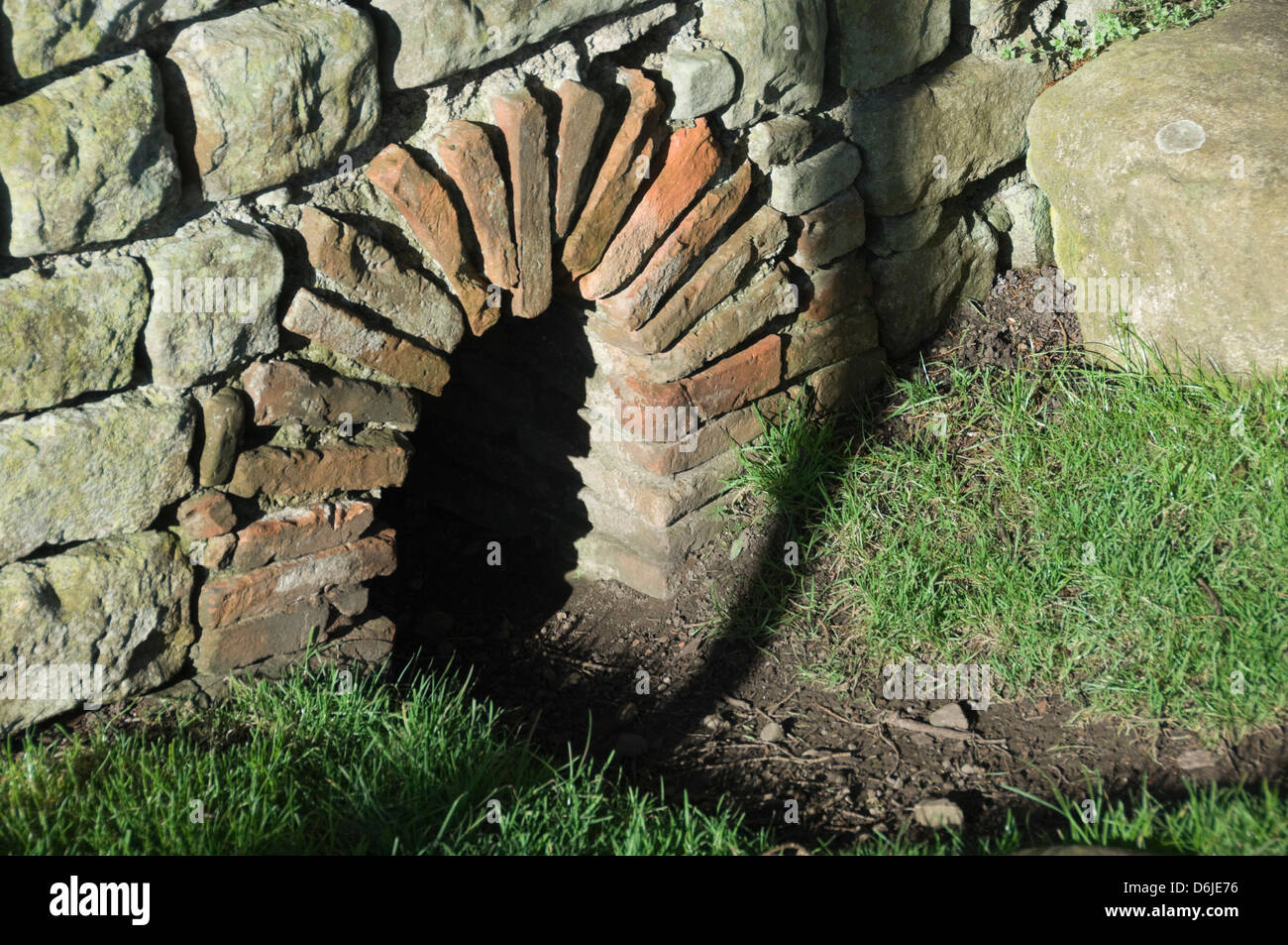 A culvert exit approximately 30 cm high, under the wall of the Cilurnum, Chollerford, Northumbria National Park, - Stock Image