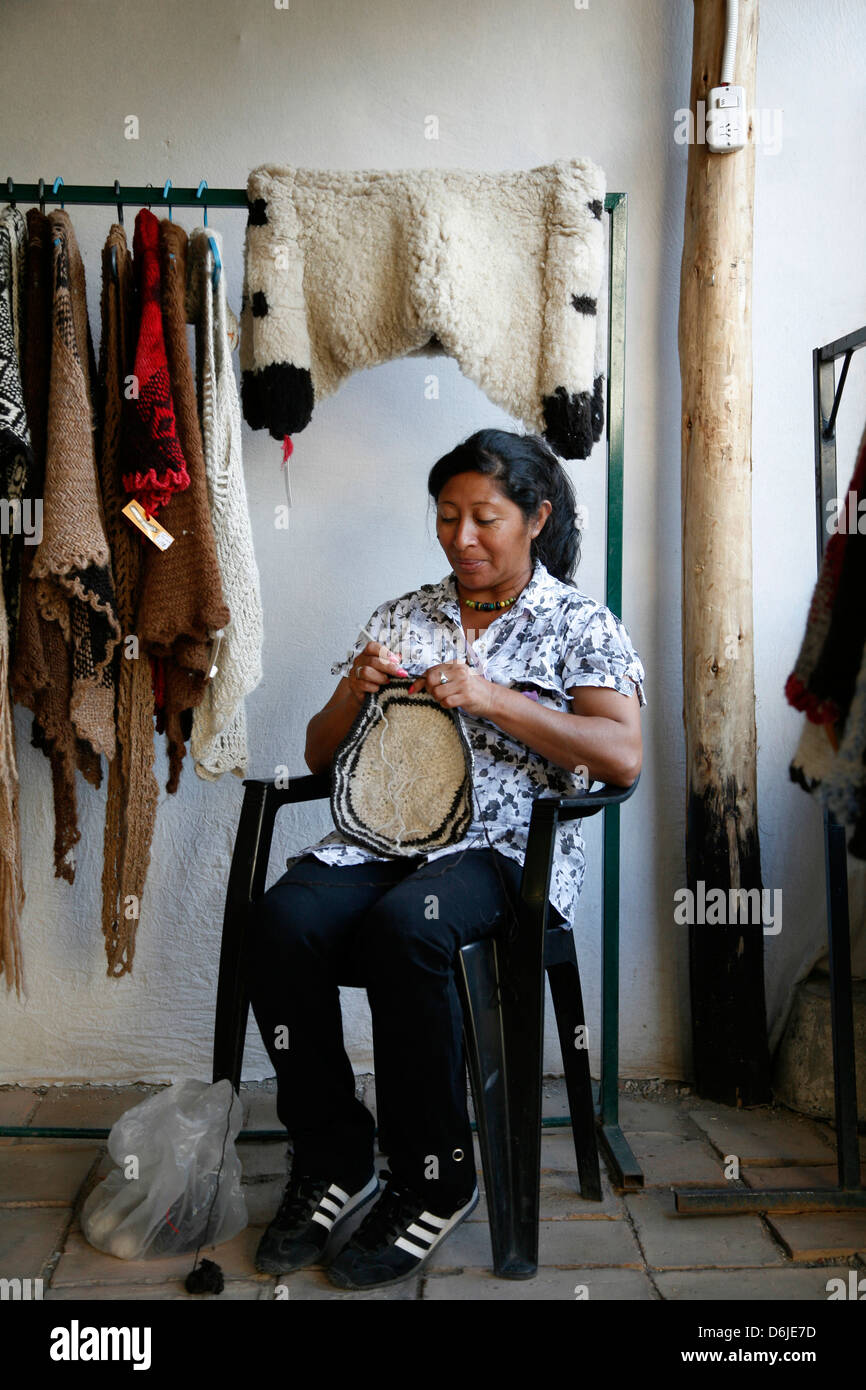 Quechua woman weaving at the market of Cafayate, Salta Province, Argentina, South America - Stock Image