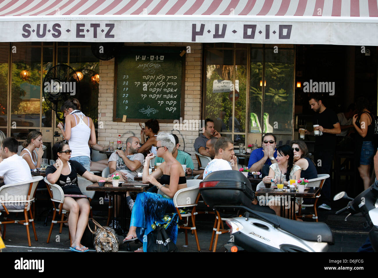 Young people sitting at Sus Etz Cafe in the trendy Sheinkin street, Tel Aviv, Israel, Middle East Stock Photo