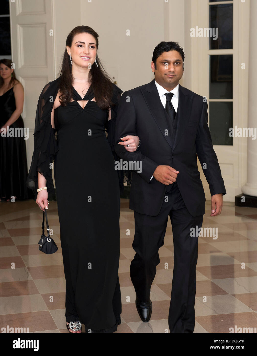 Rajiv Kumar Fernando, CEO of Chopper Trading, and Jennifer Lynn Pelaez arrive for the Official Dinner in honor of Stock Photo