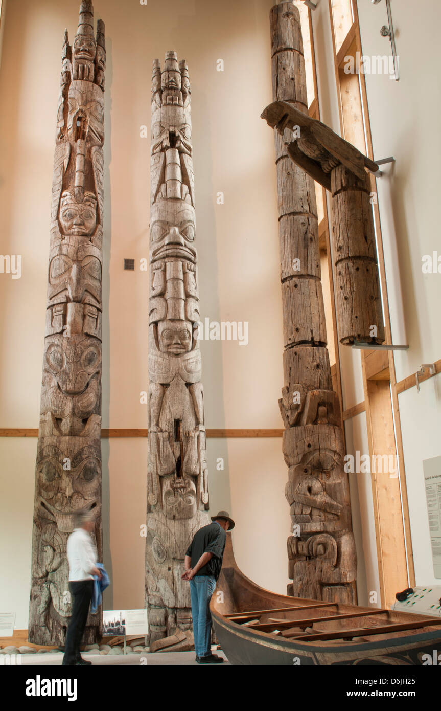 Totem poles at Haida Heritage Centre Museum at Kaay Llnagaay, Haida Gwaii (Queen Charlotte Islands), British Columbia, - Stock Image