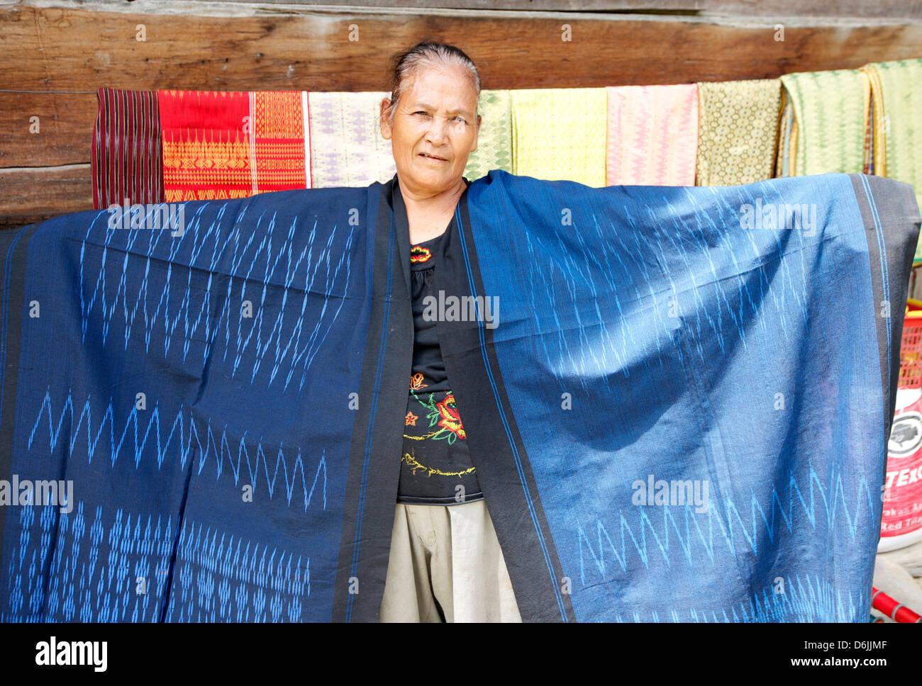 Batak tribeswoman with patterned Batak Toba sarongs, Buhit, Samosir Island, Lake Toba, Sumatra, Indonesia, Southeast - Stock Image
