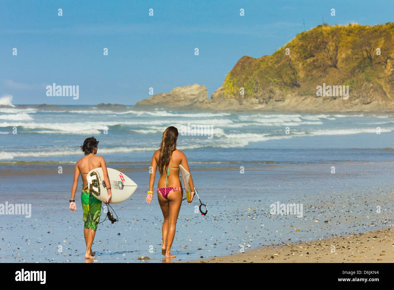 Boy And Girl With Surfboards At Playa Guiones Beach Nosara Nicoya Peninsula Guanacaste Province Costa Rica Central America