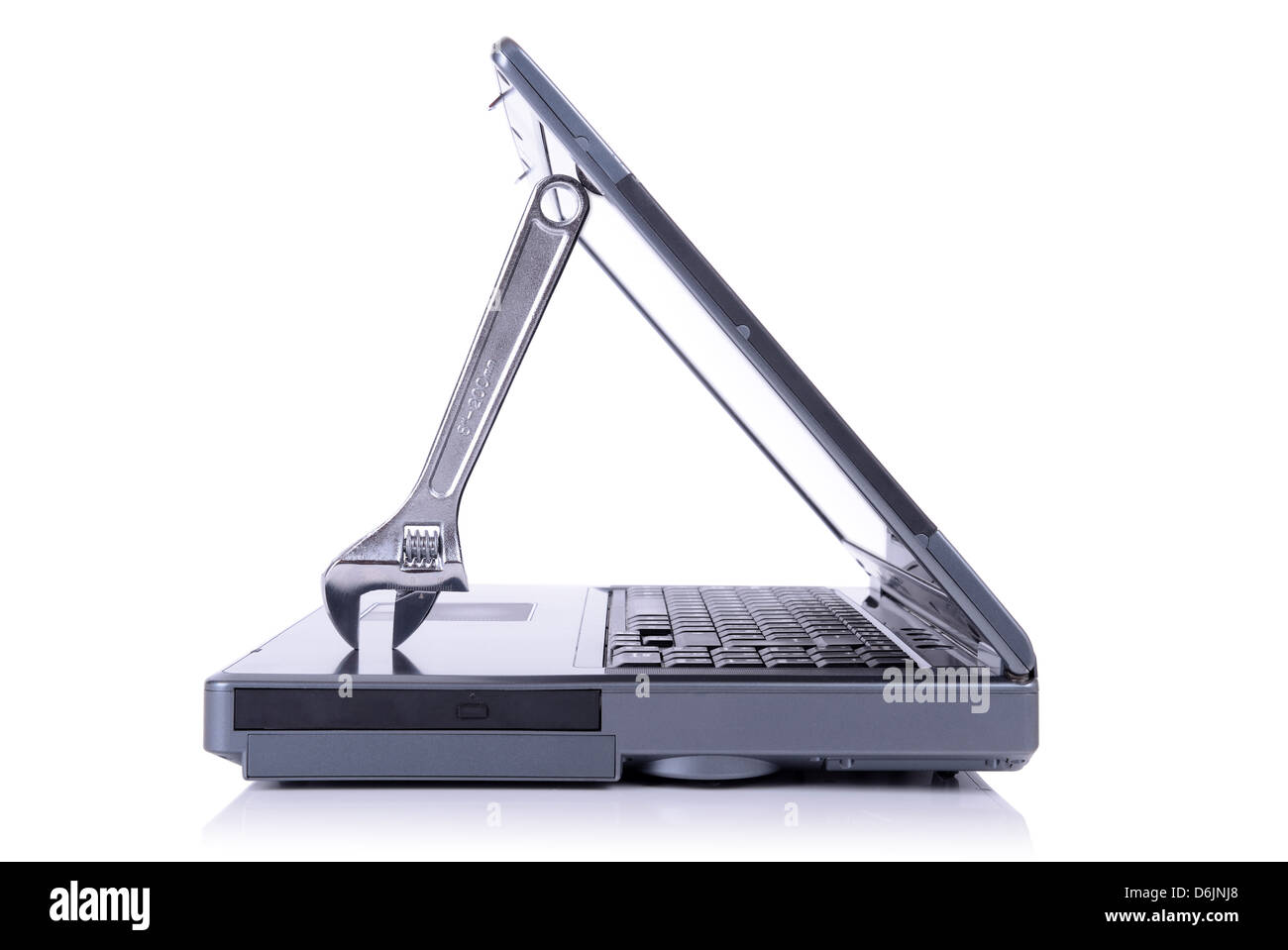 concept of it support with a spanner holding open a laptop isolated on white background - Stock Image