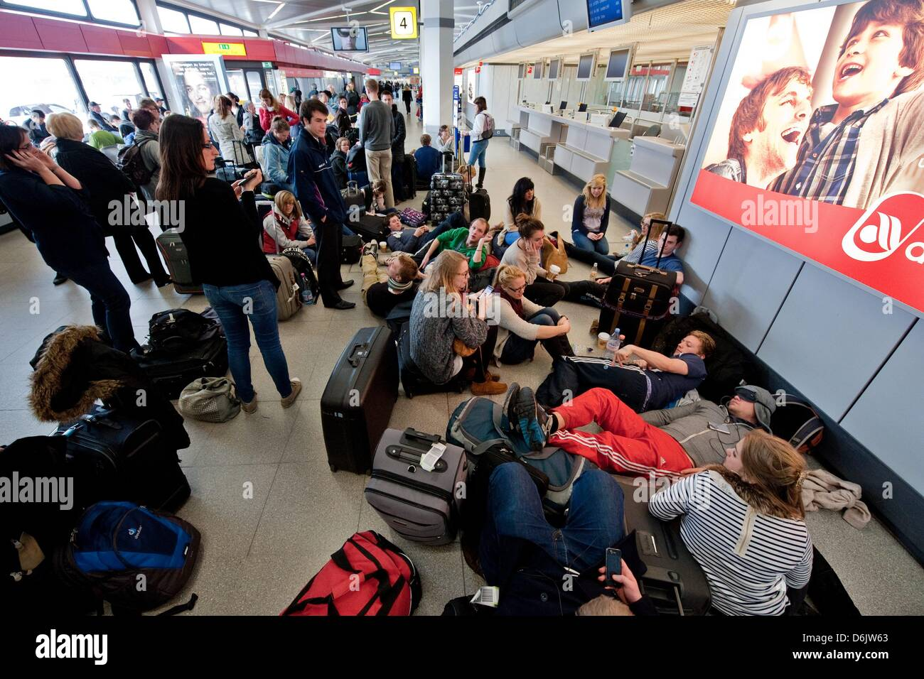 People wait for their flights during a warning strike at tegel